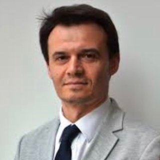 Dr. Lucian Cernat
